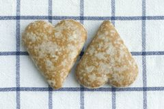 Two gingerbread cookies in the form heart. stock photo