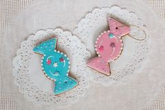 Two gingerbread cookies in the shape of candy on a white napkin background. Top view, flat lay, copy space. Curly. Christmas gingerbread home cooking Stock Photography