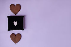 Two gingerbread cookies with soft small pillow. Top view Royalty Free Stock Photo