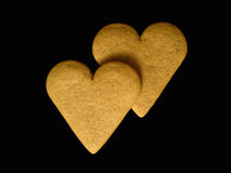 Two gingerbread hearts isolated on a black backgro Stock Photography