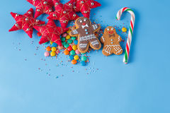 Two gingerbread man on blue background Royalty Free Stock Image