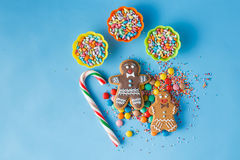Two gingerbread man on blue background Stock Images