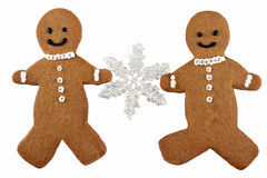 Two Gingerbread Man Cookies Holding a Snowflake Stock Images