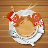 Two gingerbread mans in cup of hot coffee Royalty Free Stock Photography