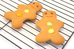 Two Gingerbread Men on a Cooling Rack. Focus is on the face of the right hand man Royalty Free Stock Image