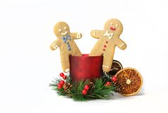 Two gingerbread men sitting in New Year's decoration Stock Photo