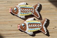 Two gingerbread in the shape of fish. Gingerbread in the shape of animals and other objects, decorated in traditional folk style from Arkhangelsk and North royalty free stock image