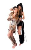 Two girl in barbarian and cat costumes Royalty Free Stock Images