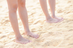 Two girl barefoot on the beach Royalty Free Stock Images