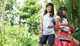 Two girl and bike Stock Image