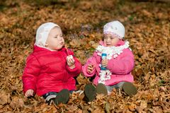 Two girl blowing bubbles outdoors Stock Images