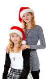 Two girl with christmas hat Royalty Free Stock Images