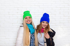 Two girl couple smile wear winter colorful hats jacket Stock Photography