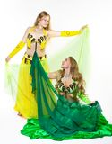 Two girl dance with veil Stock Photos
