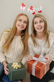 Two girl dreaming about the contents of the boxes Royalty Free Stock Photo