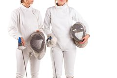 Two fencers, in a fencing uniform, hold a special fencing mask in their hands. Isolated on white background. royalty free stock images