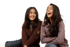 Two girl friends. Two beautiful Indian girl friends smiling together Royalty Free Stock Image
