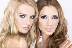 Two  girl friends - blond and brunette Royalty Free Stock Image