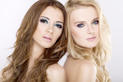 Two  girl friends - blond and brunette Royalty Free Stock Photography