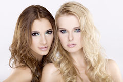 Two  girl friends - blond and brunette Stock Image