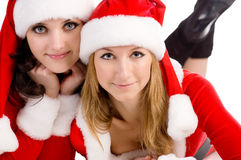 Two girl friends in christmass costumes. Stock Photos