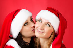 Two girl friends in christmass costumes Royalty Free Stock Photography
