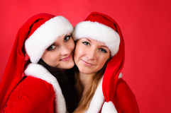 Two girl friends in christmass costumes Royalty Free Stock Photo