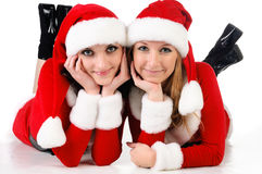 Two girl friends in christmass costumes. Royalty Free Stock Photo