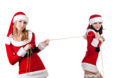 Two girl friends in christmass costumes. Stock Photography