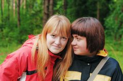 Two girl-friends in forest Royalty Free Stock Photography
