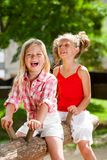 Two girl friends having great time in playground. Royalty Free Stock Photography