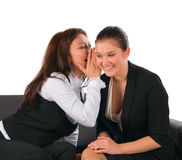 Two girl-friends lovely talk and share secrets Royalty Free Stock Image
