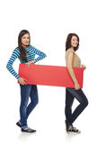 Two girl friends with red banner Royalty Free Stock Photos