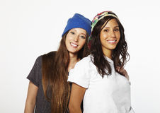 Two girl friends skateboarding smiling Royalty Free Stock Photography
