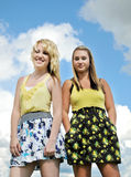 Two girl friends standing smiling stock photos