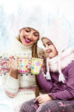 Two girl friends talk and drink tea Royalty Free Stock Image