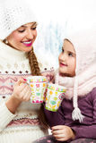 Two girl friends talk and drink tea Royalty Free Stock Photography