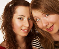 Two girl friends together smiling Royalty Free Stock Photos