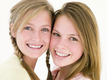 Two girl friends together smiling Royalty Free Stock Photo