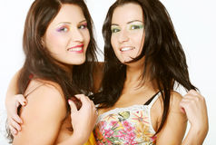 Two girl friends together smiling Royalty Free Stock Images