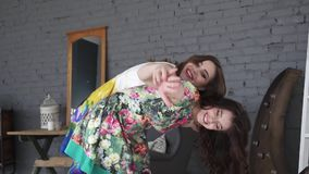 Two girl friends young female friends giving piggyback on vacation laughing and smiling. slow motion. Two girl friends young female friends giving piggyback on stock footage