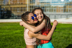Two girl friends with zizi cornrows dreadlocks hugging each other Stock Photos