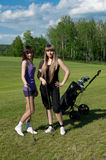 Two girl on golf field Stock Images