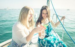 Two girl having fun on the boat with cocktails Royalty Free Stock Photos