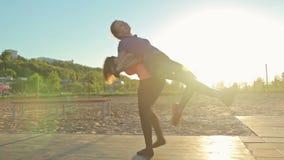 Two girl having fun, piggyback ride. At sunset stock footage