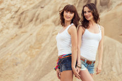 Two girl holding hands on beach Royalty Free Stock Photos