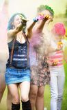 Two girl during Holi festival throw color paints Stock Images