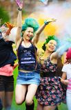 Two girl during Holi festival throw color paints Stock Photo