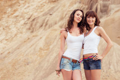 Two girl hugging on beach Stock Photos