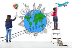 Two girl kids drawing worldwide map and famous landmark. In studio stock photography
